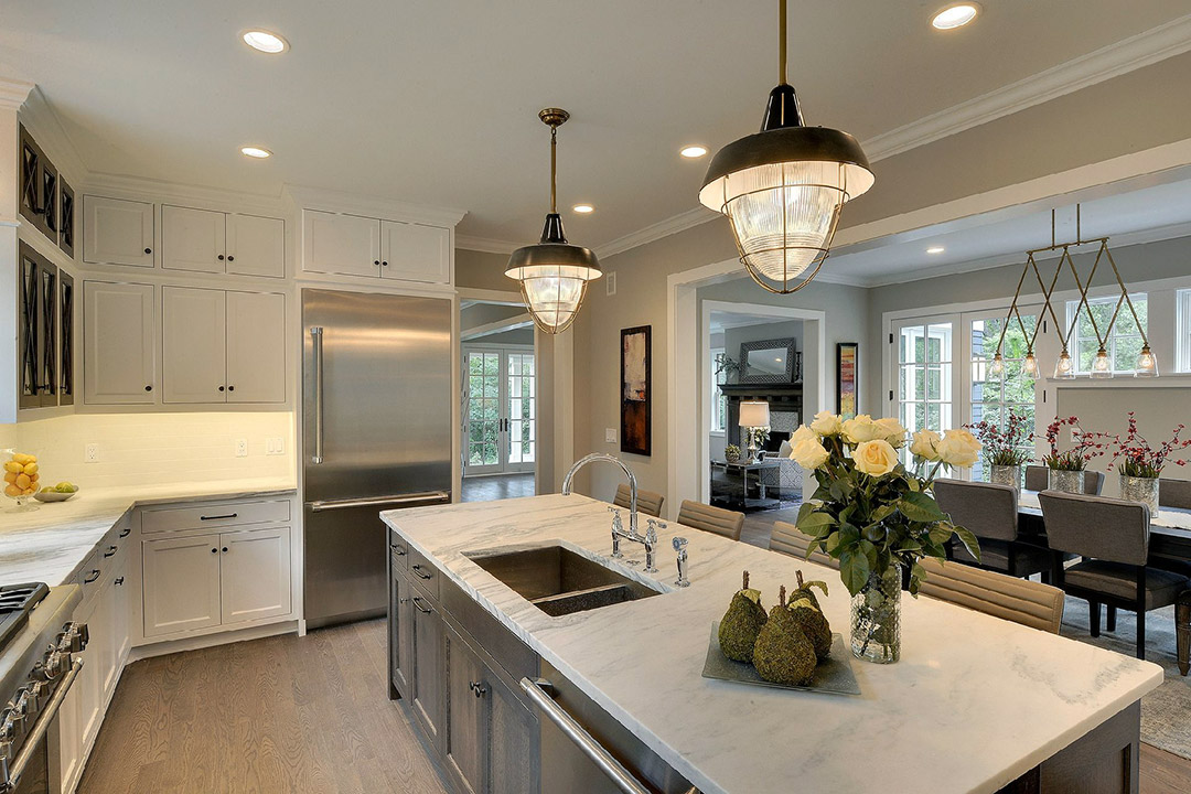 The kitchen is made to cook in, boasting a large working chef's kitchen, with top of the line appliances, a gracious center island, and enameled wood cabinetry.