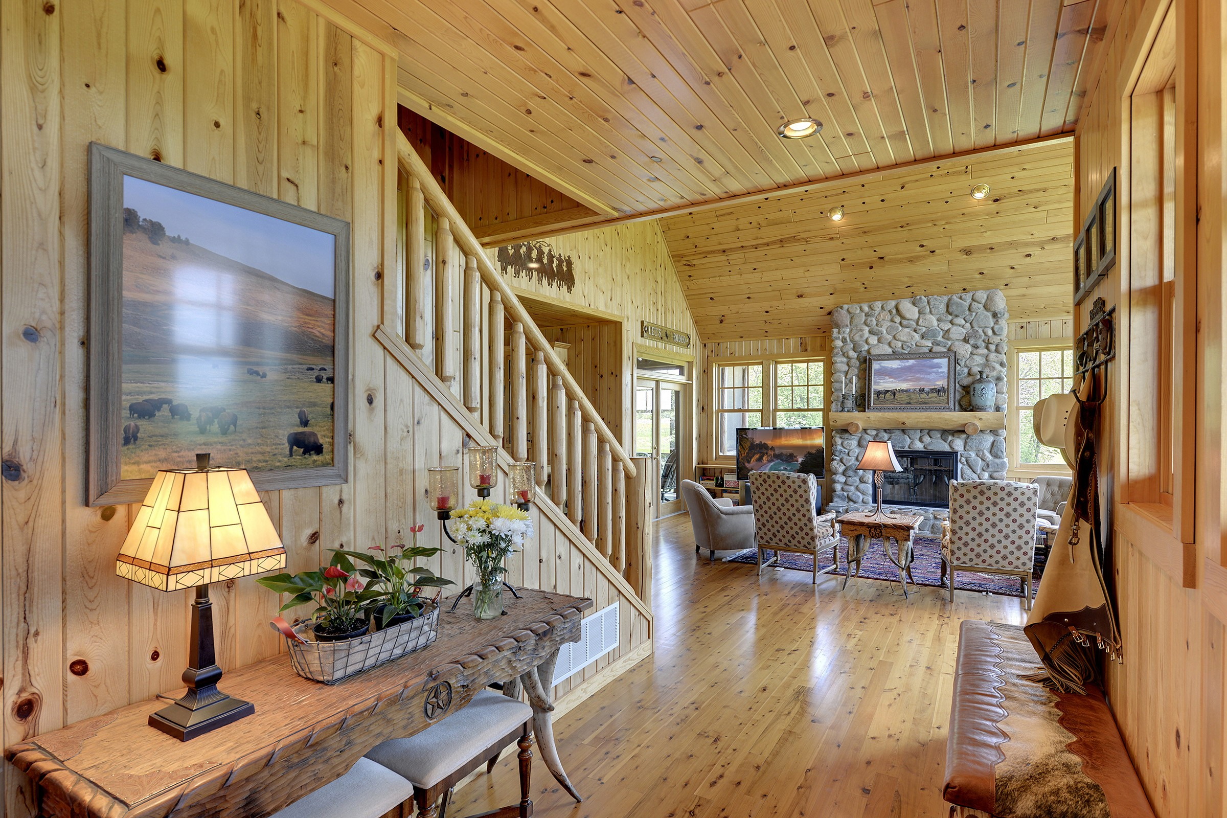 The home features hand-crafted wood throughout.
