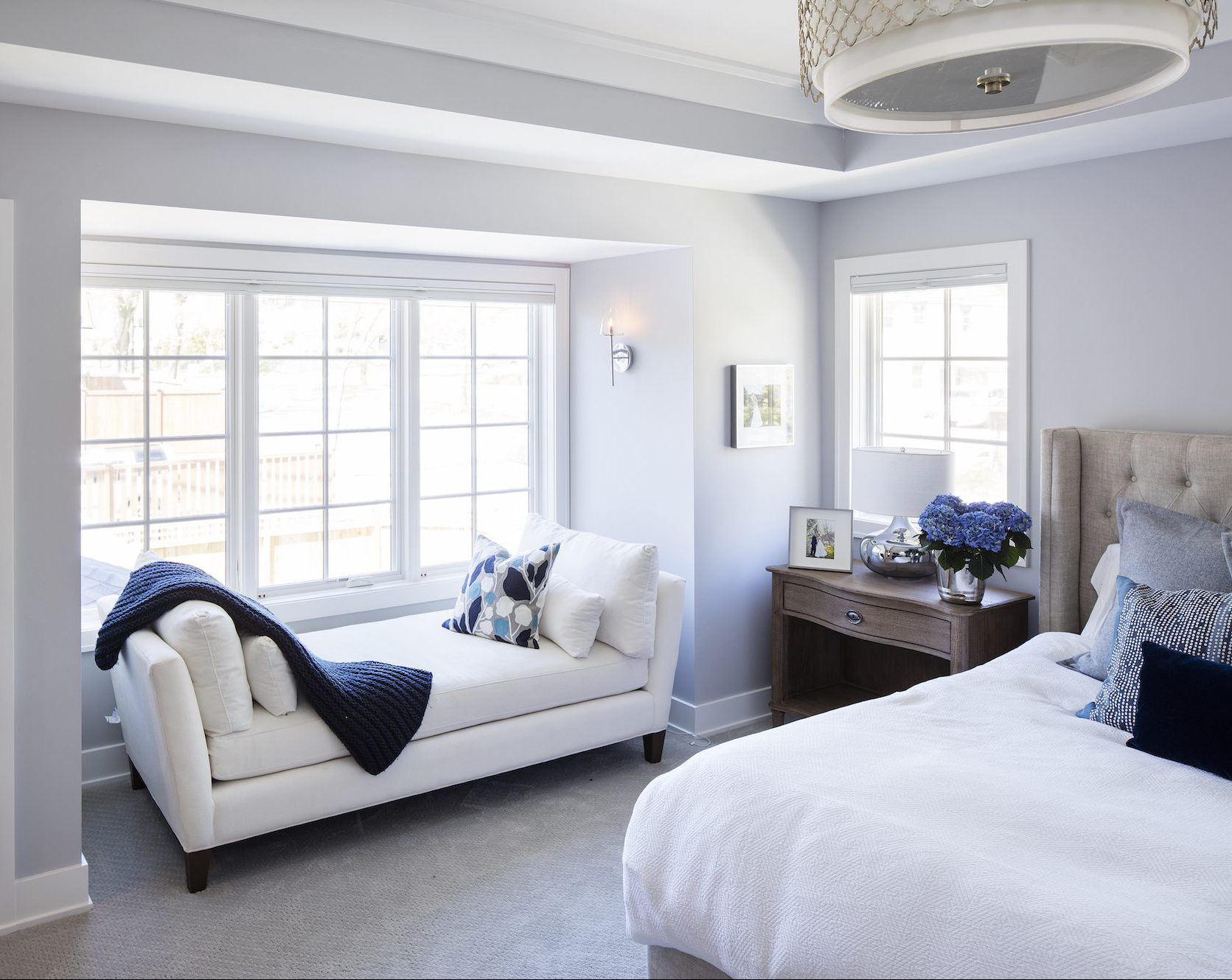 The master suite features unique ceiling detail and a cozy reading nook.