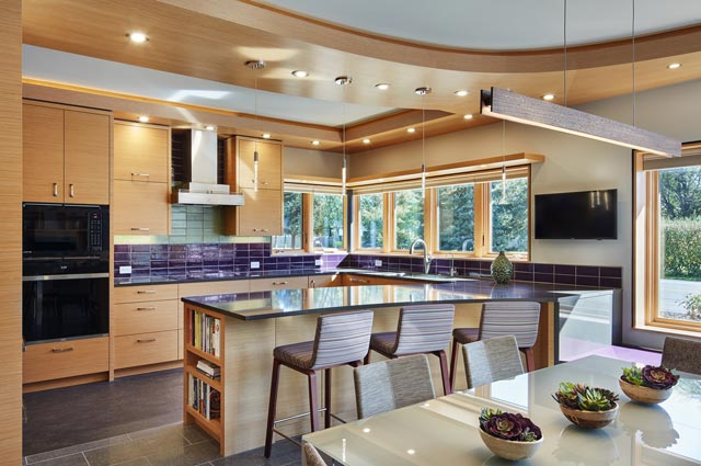 The cabinetry is composed of recycled wood sourced from the midwest, counters are locally-produced by Cambria, and appliances are Wisconsin-based Wolf/Sub-Zero.  Recessed lights are in wood soffits to minimize air leaks.